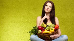 woman holding veggies