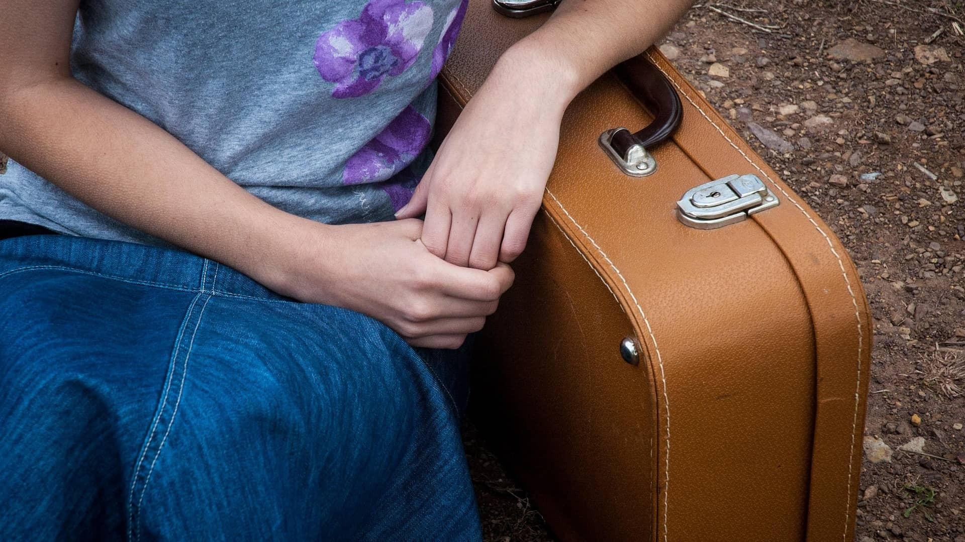 girl and suitcase-solo female traveler