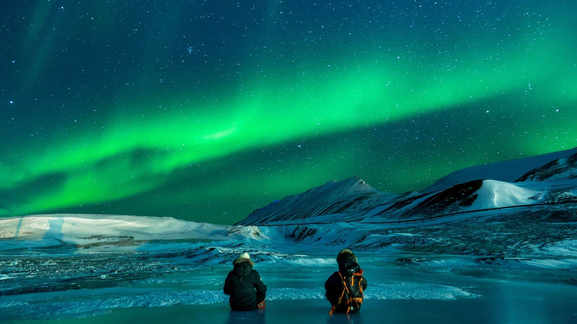 two people watching northern lights-get out of your comfort zone