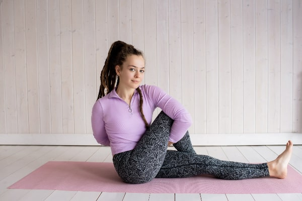 girl stretching-finding motivation to exercise at home