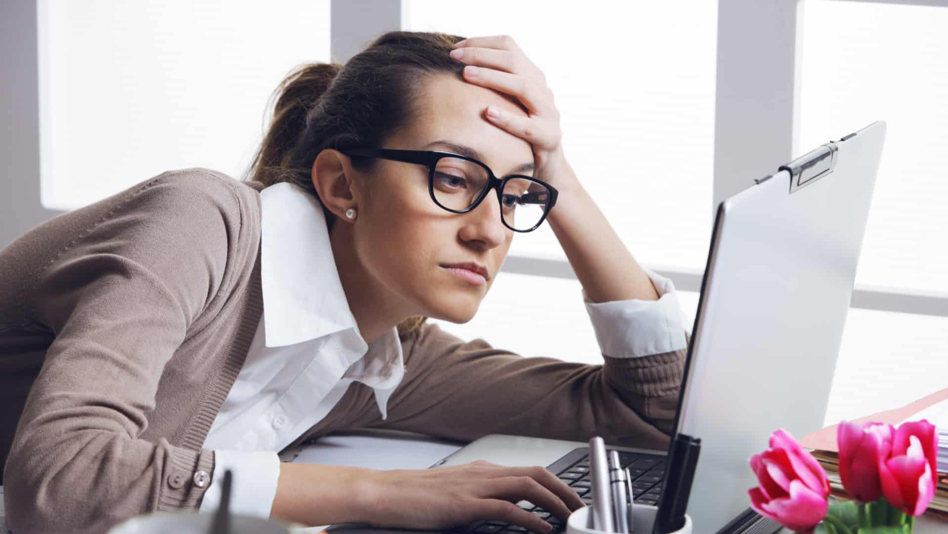 frustrated lady at desk-how to shake off a bad day