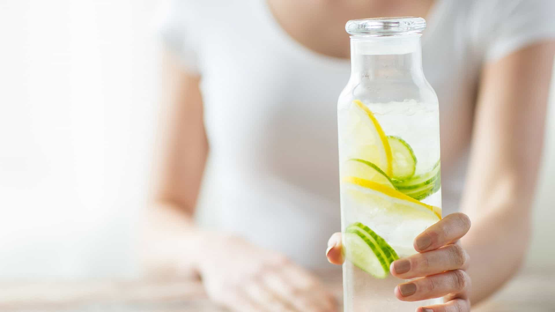 11 hacks to drink more water-lady with water pitcher