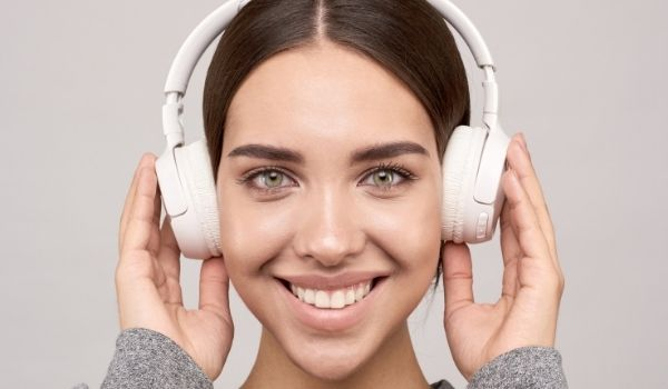 girl with noise cancelling headphones on-working from home tips