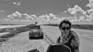woman on road by car-how to reinvent yourself blog
