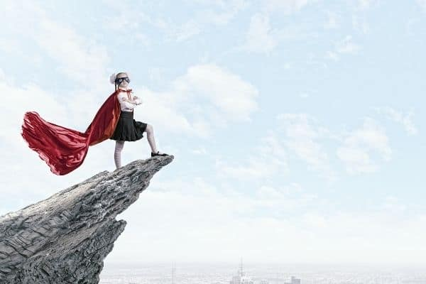 girl on mountain with cape on-how to change your life at 50