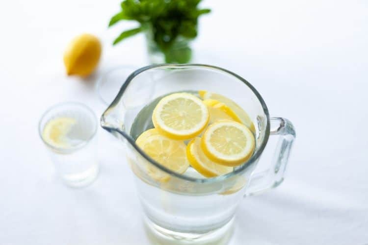 pitcher of water with lemon slices-ways to feel good blog