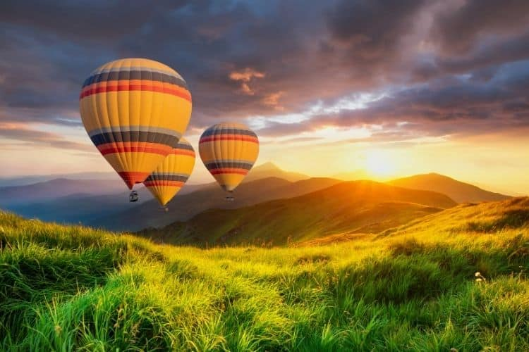 hot air balloons over a field-ways to feel good-go for an adventure