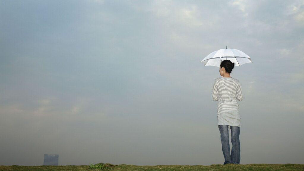 woman holding an umbrella-get through hard times blog post