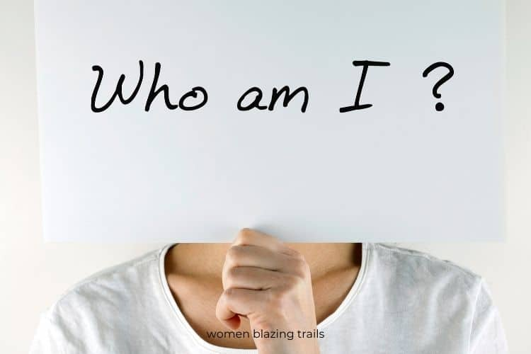 woman holding sign who am I-starting a new life alone blog