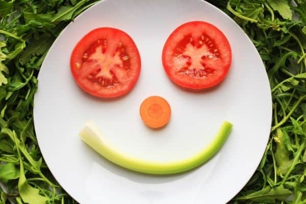 plate of food making a smily face-live a happier life blog post