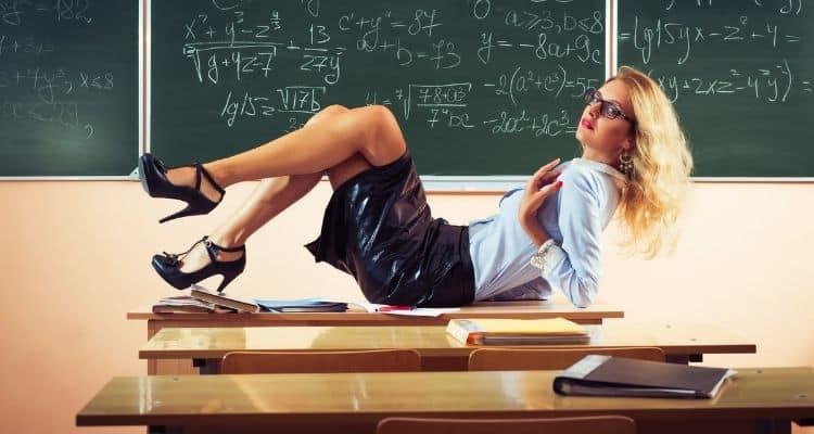 sexy teacher on desk-why younger men like older women