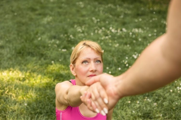 sad woman on ground-how to get out of rock bottom article